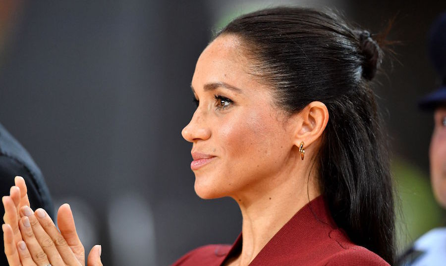 Meghan has started rocking the half-up-half-down hairstyle, and we're loving it!