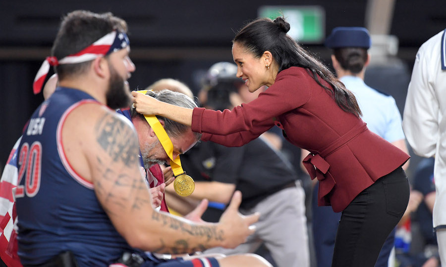 The pregnant royal handed out medals to the winners at the wheelchair basketball game.