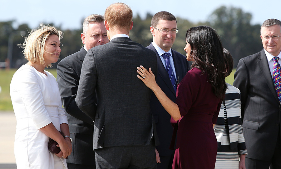 The loved-up couple showed their last display of affection in Australia as Meghan put a hand on her husband's back while they said farewell. 