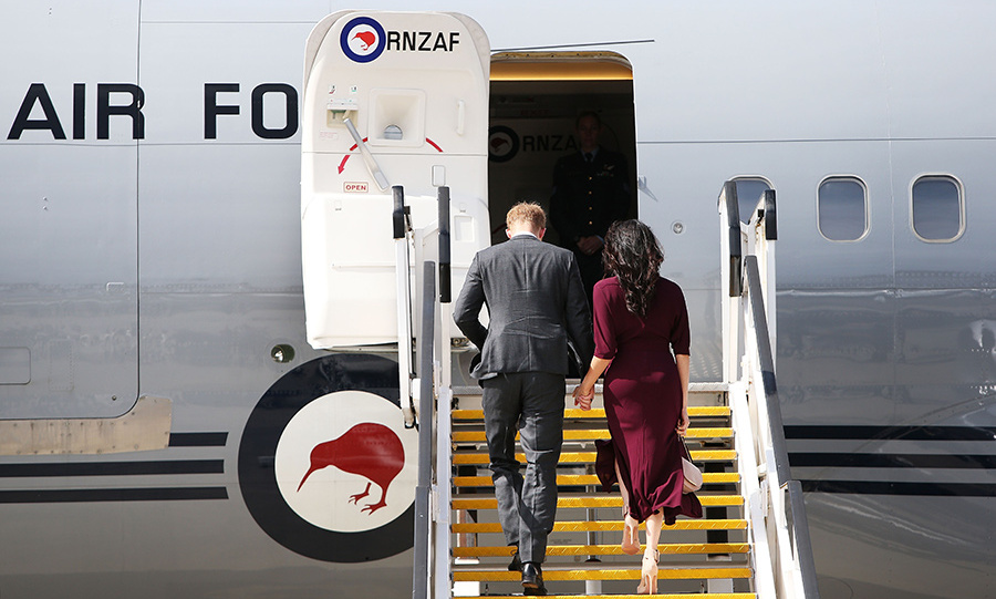 The Duke and Duchess of Sussex held hands as they boarded a plane for Wellington, New Zealand to kick off the final leg of their 16-day tour. They are flying with the Kiwi Invictus Games team, with whom they'll pose for a group photo when they arrive. 