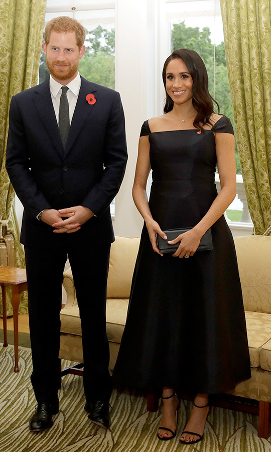 "The Sussexes swapped their day looks for chic eveningwear as they rounded out their first day in New Zealand with a reception at Government House on Oct. 28. Meghan turned to Gabriela Hearst - the sustainable designer behind her <a href=""https://ca.hellomagazine.com/fashion/02018101247814/demi-moore-bag-meghan-markle-royal-wedding"">popular wonton-shaped handbag</a> - for this gorgeous black cocktail dress with capped sleeves and a flared tea-length skirt. She accessorized with a necklace featuring a traditional Maori design, simple black heeled sandals and a black clutch. The 37-year-old topped off the look with sleek old Hollywood waves and natural makeup with a smoky eye. 