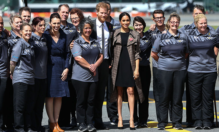 Prime Minister Jacinda Ardern and Wellington mayor Justin Lester and his wife greeted Prince Harry and Meghan on their arrival in Wellington, New Zealand. The group posed with the country's Invictus Games competitors, who were on their flight. 