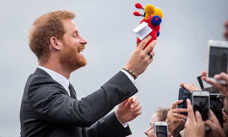 Dad-to-be Prince Harry was delighted by a moment of nostalgia as he chatted with crowds during his walkabout. The royal was gifted an iconic Busy Bee toy, which his brother Prince William played with while on tour with Prince Charles and Diana in 1983.