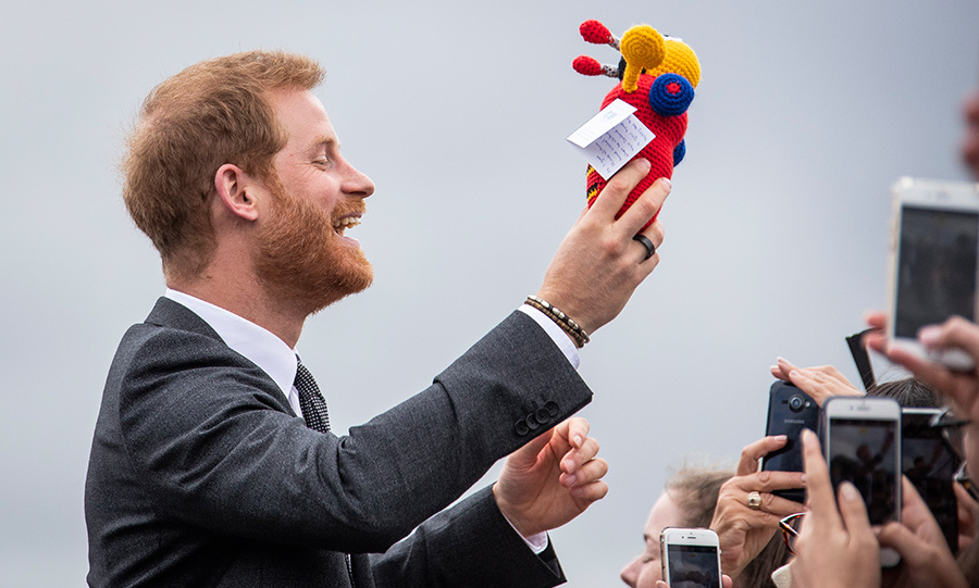 Dad-to-be Prince Harry was delighted by a moment of nostalgia as he chatted with crowds during a walkabout at Pukeahu National War Memorial Park in Wellington, NZ on Oct. 28. The royal was gifted an iconic Busy Bee toy, which his brother Prince William played with while on tour with Prince Charles and Diana in 1983.