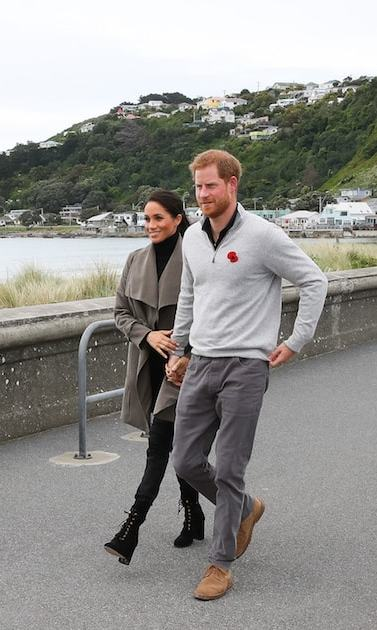 The pregnant duchess stunned in a grey Club Monaco 'Ellayne' trench coat, the Jac and Jack 'Twain' turtleneck, Outlander 'Harriet' jeans and Stuart Weitzman 'Veruka' boots.