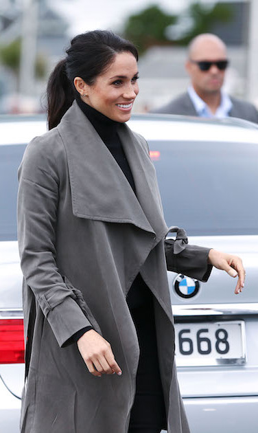 Meghan looked radiant in her chic fall outfit and ponytail.