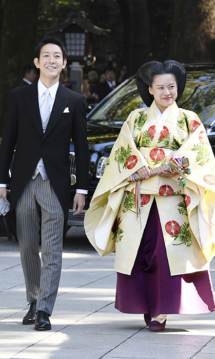The happy couple met at the shrine, the venue of their wedding, looking happy as ever to spend the rest of their lives together.