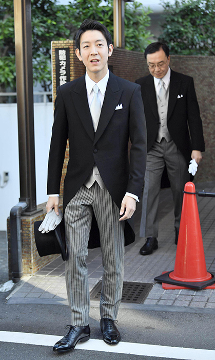 Kei Moriya, an employee for shipping company Nippon Yusen, left his home in Tokyo to head to his wedding ceremony. He wore a classic European morning coat with striped grey trousers, a grey vest and matching tie, carrying gloves and a black top hat.
