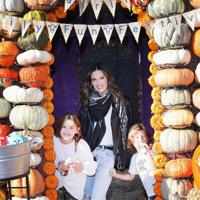 "Supermodel Alessandra Ambrosio got in the spooky spirit with kids Noah, 6, and 10-year-old Anja. ""Had such an awesome day with the kidos at the #fairlifefest @mrbones  ! Loved all the Halloween pumpkin treats made with @fairlife,"" she wrote on Instagram.