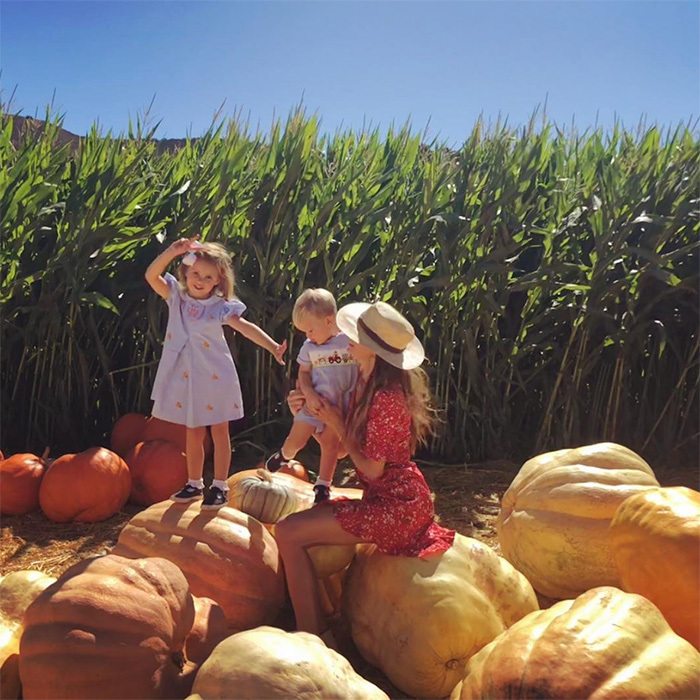 "Elizabeth Chambers, wife of Hollywood star Armie Hammer, enjoyed the fall sunshine with their kids Ford, 1, and three-year-old Harper. The caption read: ""Pumpkin perch""!