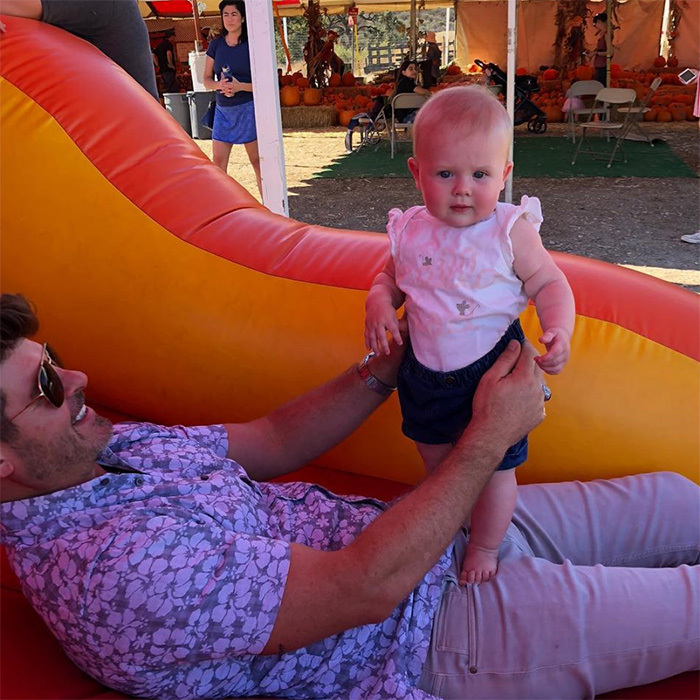 "Singer Robin Thicke had the best time with his little one, eight-month-old Mia, at the pumpkin patch! His wife, April Love Geary, shared this sweet snap, followed by another of Mia and her older brother, eight-year-old Julian. ""My favorite pumpkins,"" she captioned it.