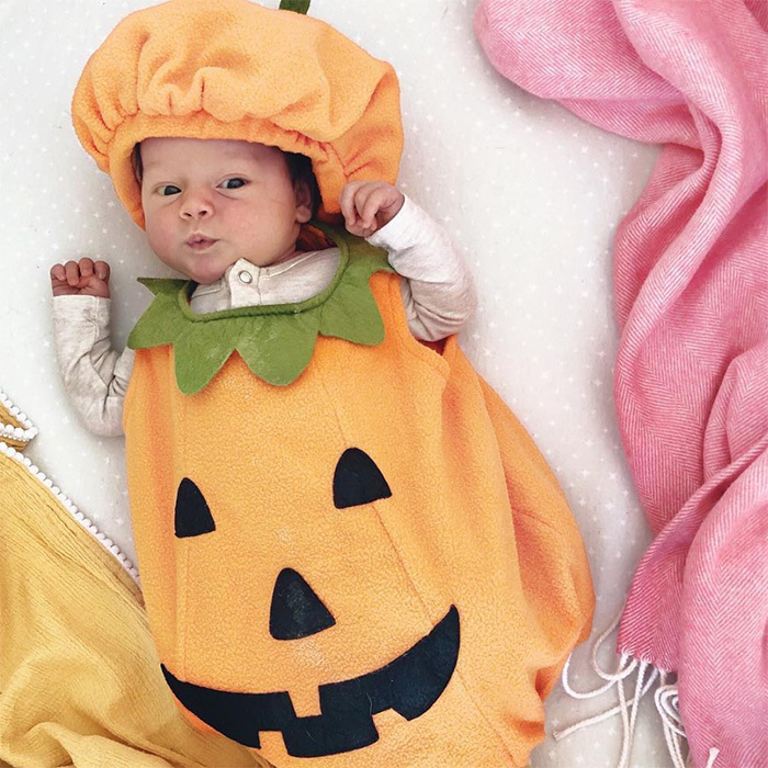 "Jillian Harris' newest bundle of joy arrived just in time for adorable Halloween costumes! Little three-week-old Annie got to dress up in orange for the holidays. ""Annie's OOTD is her big brother's very FIRST Halloween costume,"" the mother of two wrote.