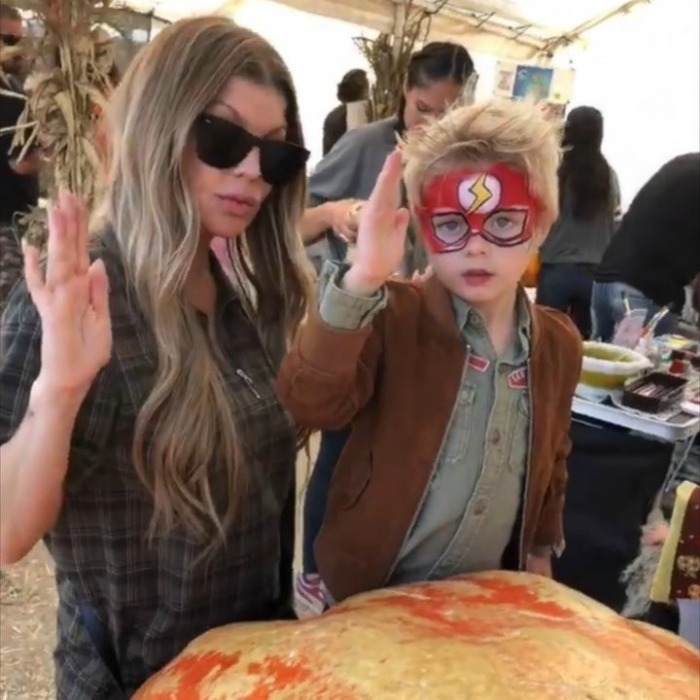 "Fergie and her son, Axl Jack, got dressed up to search for the perfect pumpkins. ""My fast lil Flash,"" the singer wrote on Instagram.