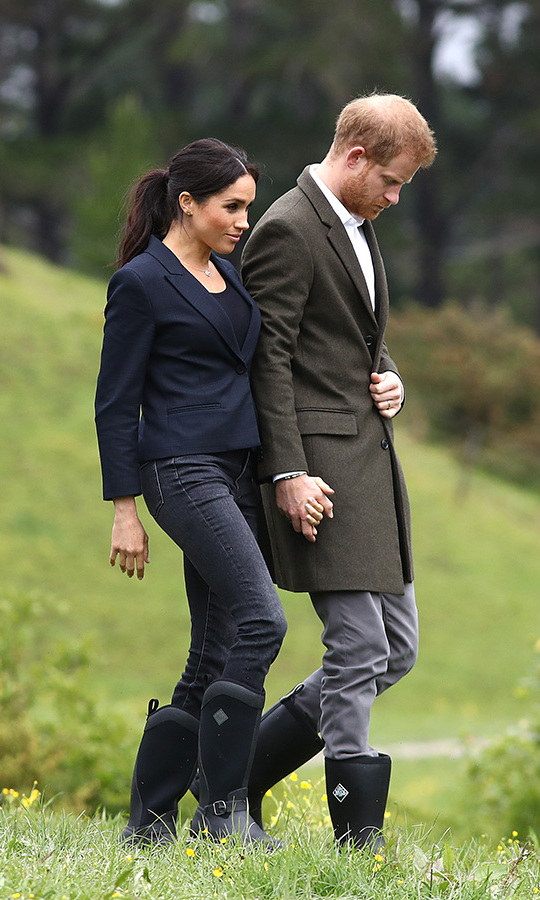 The Duke and Duchess of Sussex arrived in Auckland on Tuesday (Oct. 30) to kick off the second-last day of their tour on the North Shore. They unveiled a plaque dedicating a 20-hectare piece of native bush to the Queen's Commonwealth Canopy before partaking in some welly-wanging (rainboot tossing!).