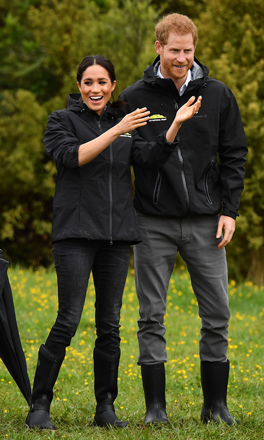Meghan was clearly having a ball during her first game of welly-wanging! To toss the gumboots, the couple changed into windbreakers. 