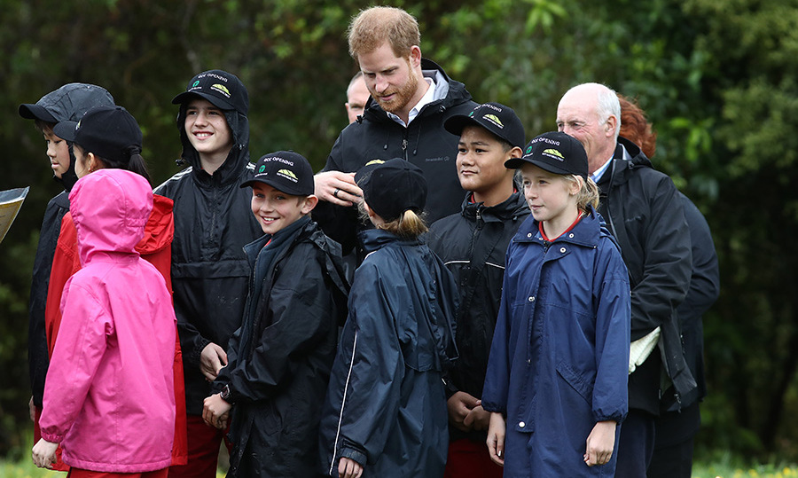 "Prince Harry chatted with the kids from Trees for Survival, a program that educates children to ""inspire young environmentalists"" - something Harry can definitely get behind! The kids grow and plant native trees in erosion-prone land. 