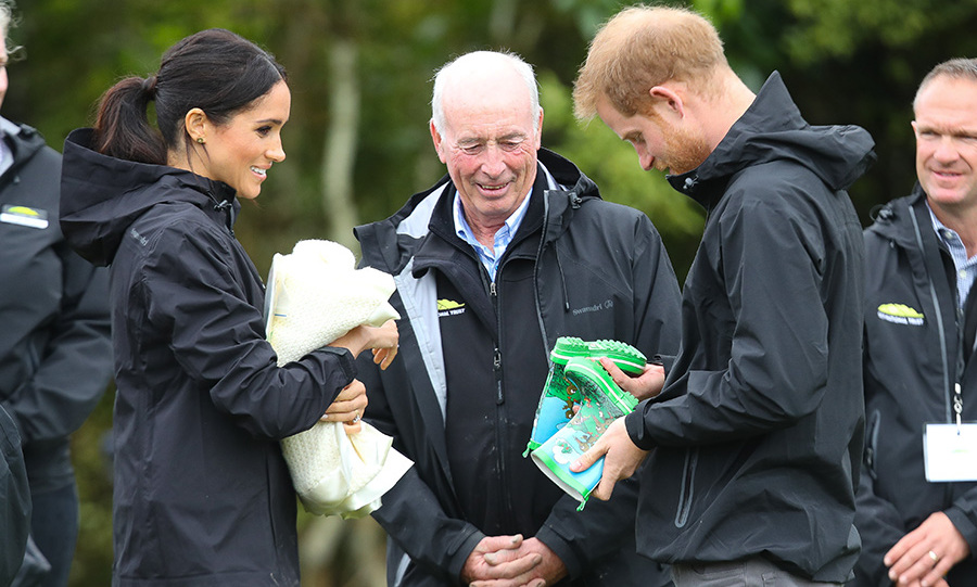 While in Auckland to dedicate a piece of native bush to the Queen's Commonwealth Canopy and partake in some 'welly-wanging,' the parents-to-be received the most adorable pair of kids' rainboots animated with a nature cartoon scene - a fitting gift as the couple braved the rain in waterproof Muck Boots. 