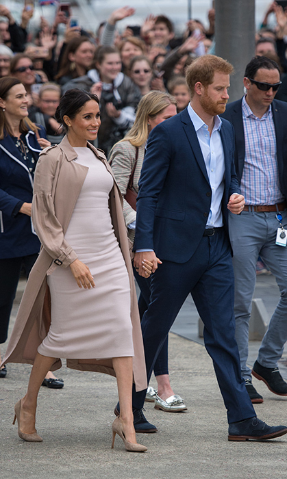 Prince Harry and Meghan stepped out on Oct. 30 looking like the most elegant couple to visit Pillars, a New Zealand charity that supports children of imprisoned parents. The duchess stunned in a beige Brandon Maxwell dress, a Burberry Bishop trench coat, Stuart Weitzman 'Legend' pumps and Boh Runga gold earrings. She wore her classic messy bun and bronzed glow for the occasion.