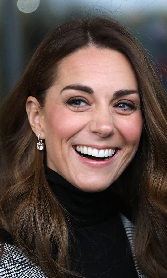 The royal wore her copper locks in her signature waves, a soft and natural makeup look with rosy cheeks and brown eyeshadow and finished the look with Kiki classic white topaz and diamond cushion drop earrings ($2,347).