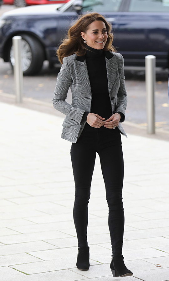 To keep warm as she arrived at Coach Core in Essex, Kate wore a two-button blazer by one of her favourite Canadian brands, Smythe, a label also loved by her sister-in-law, the Duchess of Sussex. She chose the preppy Glen Check pattern with a black corduroy upper lapel. She took a page from Meghan's recent tour style book by pairing the $795 blazer with a black turtleneck and black jeans, anchoring the chic look with Aquatalia's 'Fallon' Chelsea boots, which retail for $815. 