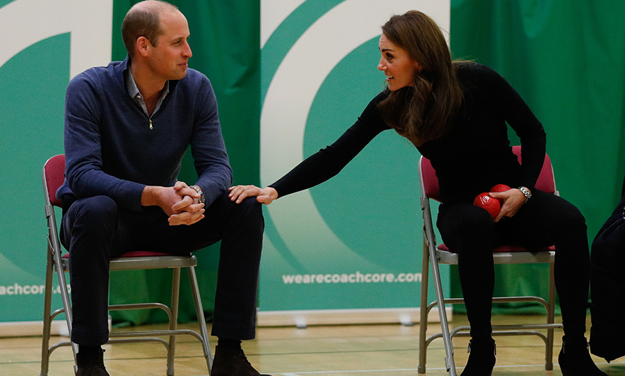 Kate couldn't resist a little PDA with her husband of seven years, touching his knee between turns while they played Boccia.