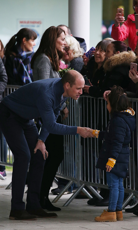 The couple seemed delighted to be back to work following their family time at Anmer Hall last week, and William had a special handshake for one of his cutest fans outside the Basildon Sporting Centre.