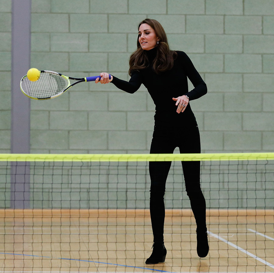 The mother of three showed off her tennis skills while on a visit to Coach Core in Essex with Prince William. Kate wore an all-black ensemble, including Aquatalia booties with small heels, as she took on the role of sports coach for the children who are involved in the program, launched three years ago by the Royal Foundation. The duchess has always loved tennis and is a regular in the Wimbledon stands each year, though she and William told Novak Djokovic this year that they're still trying to get a tennis racket in George and Charlotte's hands - and a football!
