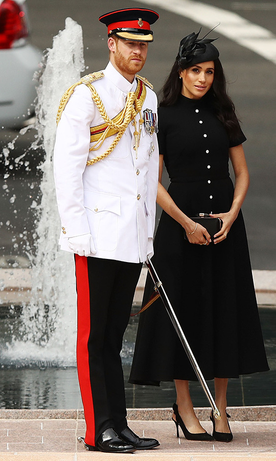 To open an ANZAC memorial in Sydney on Oct. 20, Meghan turned to royal favourite Emilia Wickstead for this pretty black midi dress with button detailing and short sleeves. She slipped on a new pair of slingbacks by Tabitha Simmons (a break from her beloved Aquazzura Deneuve Bow pumps) and a Philip Treacy fascinator, clutching a Givenchy bag to finish off the look. The duchess upped the glamour a bit with her makeup look, bronzy illuminated skin with a smoky eye and pink lip, and wore her hair in soft waves. 