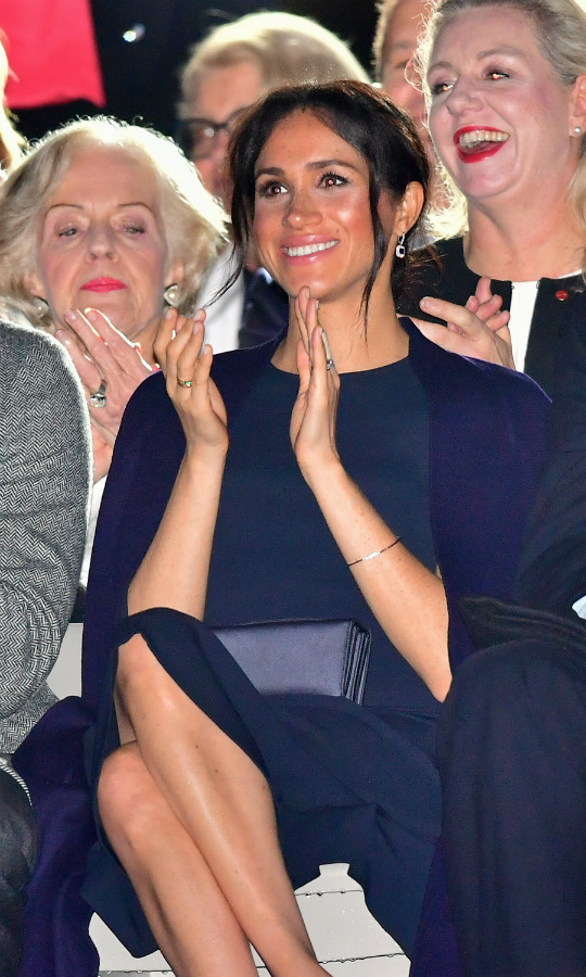 To celebrate the opening of the Invictus Games, the Duchess of Sussex represented for Team GB in a stunning navy Stella McCartney dress. She paired the elegant frock with a matching coat from a capsule collection designed by actress Gillian Anderson for Winser London. Nude Stuart Weitzman pumps, a pair of sapphire and diamond drop earrings and complementary clutch completed her perfect evening ensemble. 