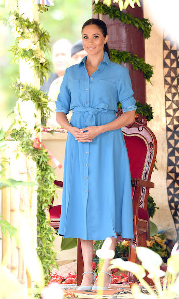 A speedy outfit change later found the former actress in a beautiful blue 'Cary' dress by American brand Veronica Beard, which features a small slit up the side. Bunching the sleeves up at her elbows for a casual yet chic look, she kept her hair up the ponytail. Meghan also debuted a new pair of light blue heels with a delicate ankle strap.