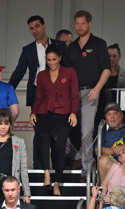 For Prince Harry and Meghan's final day in Australia on Oct. 26, they attended the wheelchair basketball competition at the Invictus Games. The duchess stunned in a casual yet elegant look! She paired her Theodore Scanlan crepe knit jacket with a pair of black 'Harriet' jeans by Outlander and Sarah Flint 'Jay' pumps. Keeping her hair in a half up, half down style, Meghan showed off her pretty gold Shaun Leane 'Talon' earrings.