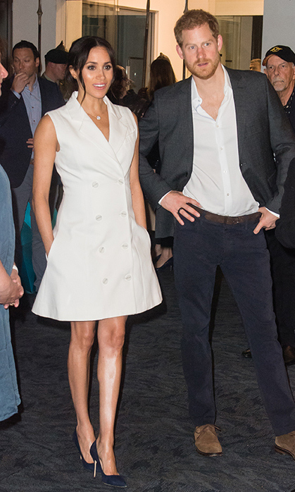 "The Sussexes ended their day in Wellington on Oct. 29 with a visit to Courtney Creative for an event celebrating the Kiwi capital's thriving creative arts scene. Duchess Meghan broke out another amazing tuxedo look in a customized ""Leap of Faith"" dress by New Zealand designer Maggie Marilyn, paired with navy suede ""BB"" Manolo Blahniks and a Maori tattoo diamond pendant by Simon James.