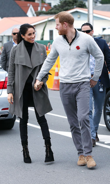 The Sussexes kept it casual for an overcast day in Wellington! Duchess Meghan looked perfectly cozy and chic for a cup of tea with young people who are working towards various mental health initiatives – a cause close to both Prince Harry and Meghan's hearts. She wore the 'Ellayne' trench coat by Club Monaco, paired with a turtleneck by Jac and Jack and Outland 'Hariet' Jeans. Her boots – the Stuart Weitzman 'Veruka' lace-up boot – were perfect for the stunning terrain of New Zealand.