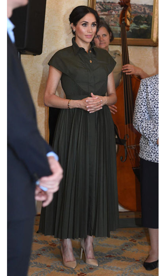 "To wrap up their first day of tour, Meghan traded her Karen Gee white shift dress for a gorgeous olive-green shirt dress by Brandom Maxwell for an afternoon reception back at Admiralty House. She paired the pretty design, which retails for almost $3,000, with nude pumps and <a href=""https://ca.hellomagazine.com/fashion/02018101647951/meghan-markle-princess-diana-earrings-bracelet-australia"">Princess Diana's butterfly earrings and bracelet</a> - sentimental pieces she debuted earlier in the day. The mom-to-be swept her locks into a low bun and opted for a smokier eye and glowing bronzed skin."