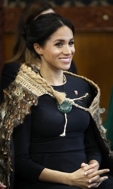 "Meghan showed off her megawatt smile at the ceremony, where she wore a traditional jade Maori necklace called a Pounamu alongside her cloak, a gift from Governor General Patsy Reddy. Designed by Kiri Nathan, the website states that the necklace ""denotes integrity, strength, status and power.""