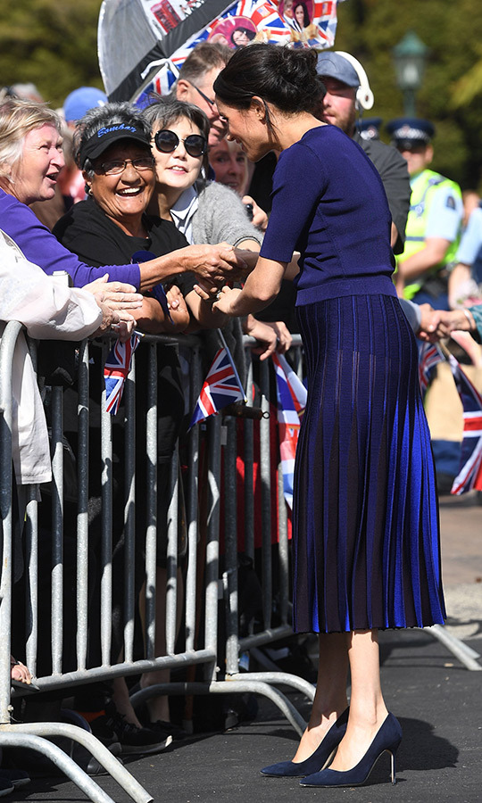 Meghan changed into a beautiful Givenchy short-sleeved sweater and pleated two-toned midi skirt for lunch and a walkabout in Rotura, which she wore with her Manolo Blahnik BB pumps. Fans were quick to point out that her skirt was sheer in the sunlight, surely an unintentional side-effect - and just another moment that brings them closer to their duchess, who has fashion faux-pas just like us!