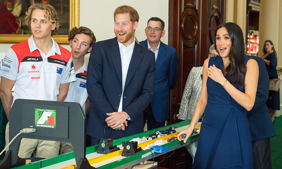 Meghan got the shock of a lifetime while setting off a louder-than-expected model Formula 1 race car at Government House in Victoria. She doubled over with laughter!