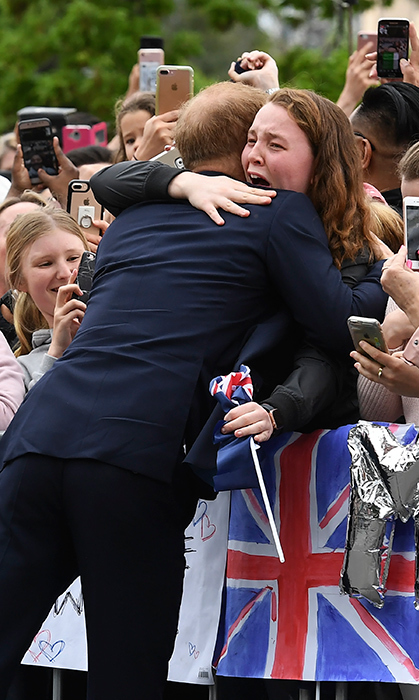 During a walkabout in Melbourne, Australia, one fan was overwhelmed at the sight of Prince Harry. Showing off his natural charm, he walked over and gave her the sweetest hug.
