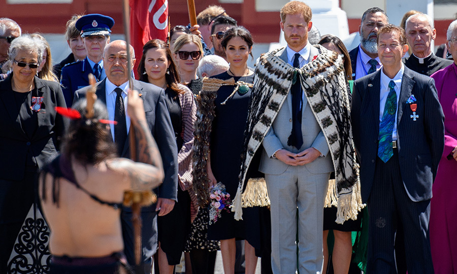 Prince Harry and Meghan donned Maori cloaks while watching a traditional haka outside of Te Papaiouru Marae in gorgeous Rotura.