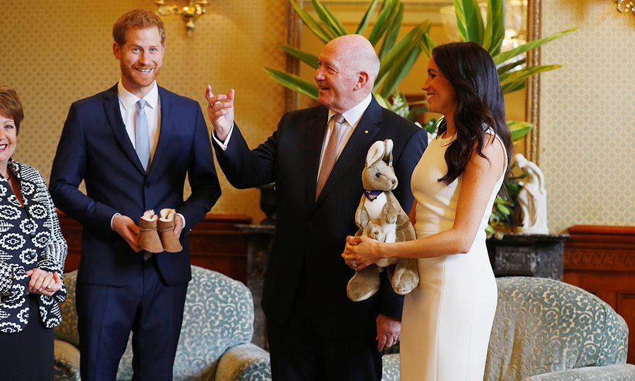 Their first of many baby gifts were an adorable pair of UGGs and a plushie kangaroo! The two had just kicked off day one of their tour with a visit with Australia's Governor General Peter Cosgrove and his wife Lynne Cosgrove at Admiralty House.