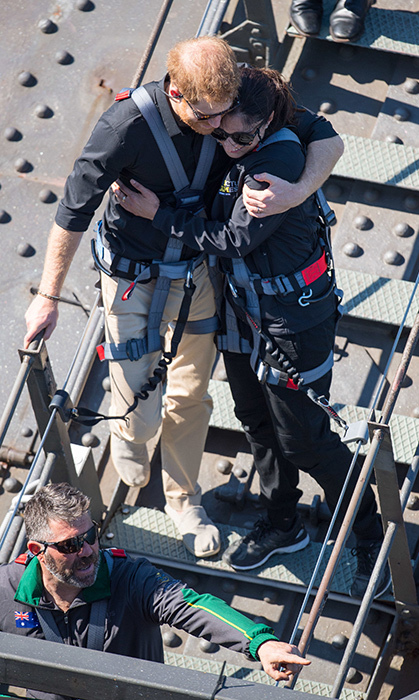 Though Duchess Meghan sat out of this adventure, Prince Harry made it to the top of the Sydney Harbour Bridge! The duke hugged Gwen Cherne, an Invictus ambassador and a war veteran's widow, who shared her story with the royal. 