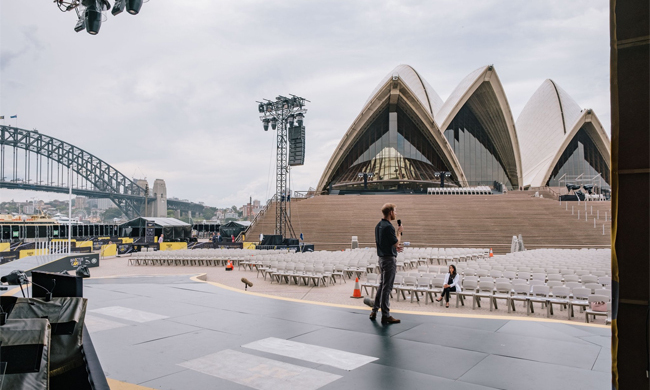 Duchess Meghan shared a picture of Harry rehearsing his speech for the Invictus Games Opening Ceremony. The snap showed her husband on stage, microphone in hand, while his supportive wife sat in the front row.