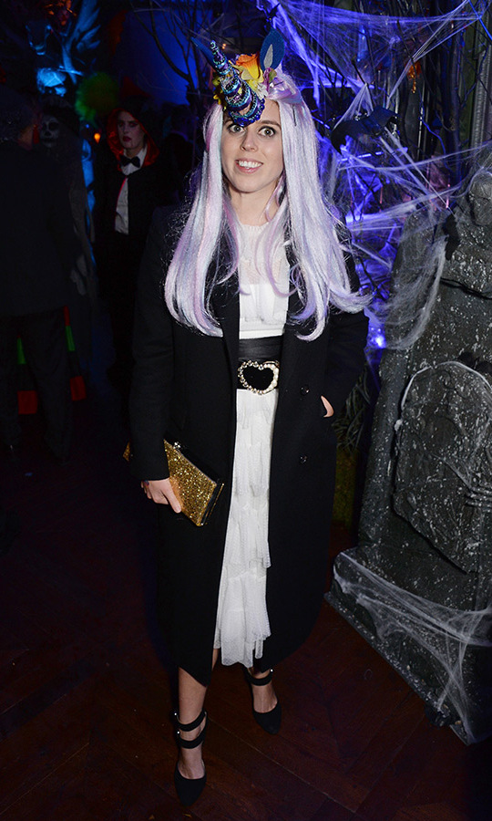 The then-30-year-old was a glam unicorn for Halloween in 2018, pairing a tiered white dress with a wide leather belt, black coat and heels and a long lavender wig with a spiral blue horn. 