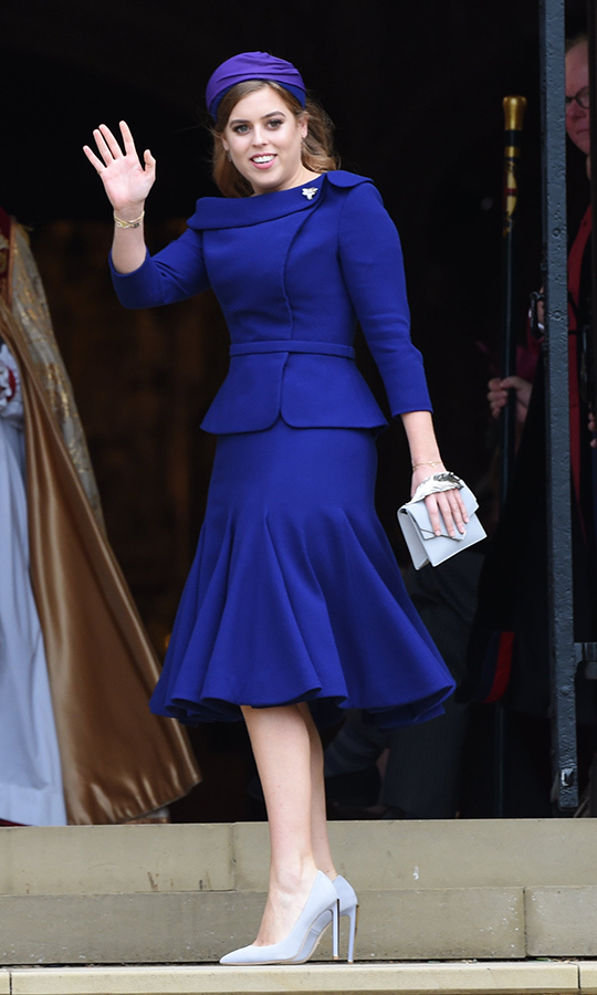 "<strong><a href=""/tags/0/princess-eugenie"">Princess Eugenie</a></strong>'s maid of honour was a vision in indigo <strong><a href=""/tags/0/ralph-and-russo"">Ralph & Russo</a></strong> on her sister's big day. She pinned a sweet bee brooch to the lapel of her boatneck dress, which featured a flared skirt, and accessorized with pale grey pumps and handbag plus a <strong>Sarah Cant</strong> headband.