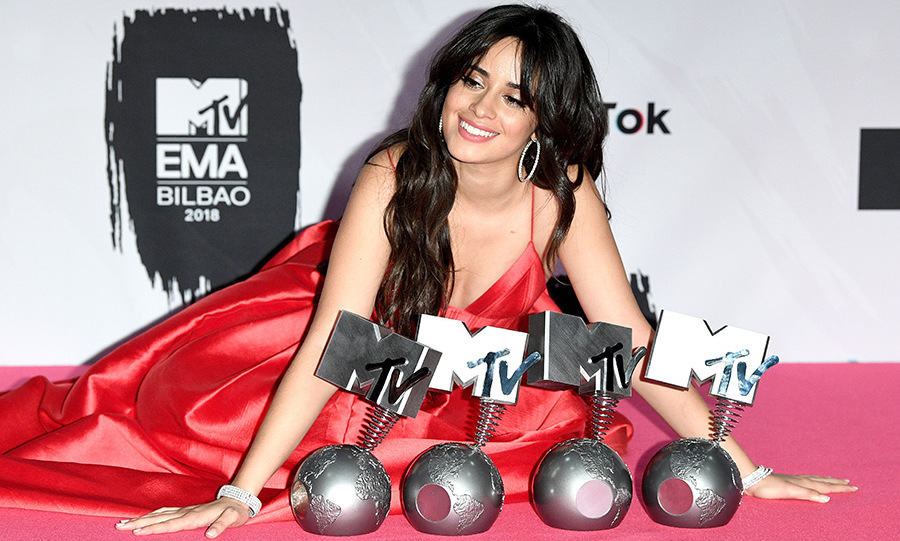 "Camila Cabello posed with her MTV EMA Awards wearing a gorgeous red Alex Perry gown and her brown locks in soft waves. The ""Havana"" singer took home the trophies for Best Artist, Best Video, Best Song and Best US Act.