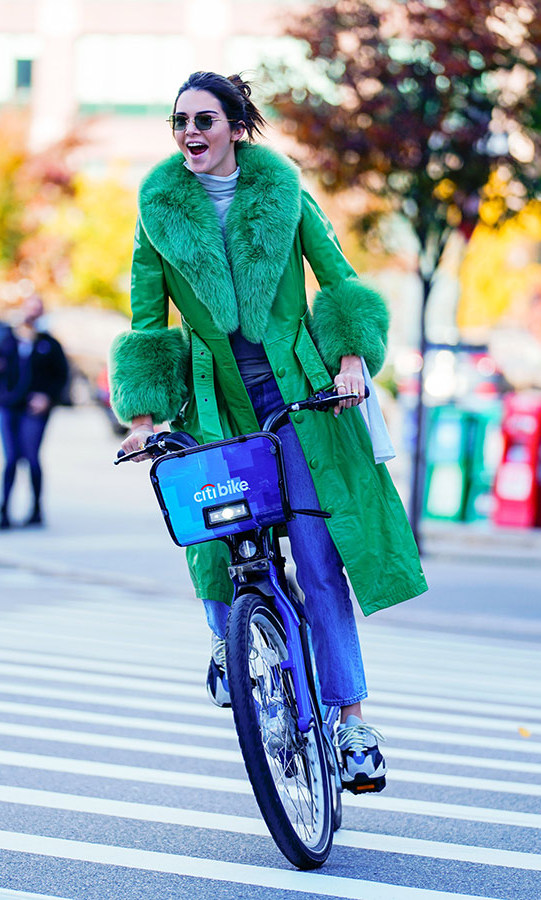 Kendall Jenner was all smiles as she biked around Soho in New York on Nov. 3, her 23rd birthday, wearing a furry green coat, jeans and sneakers.