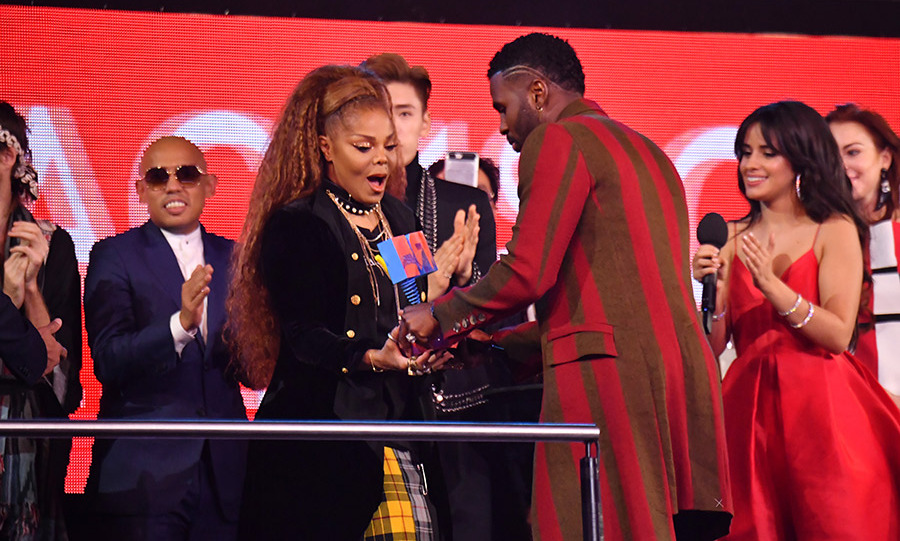 "At age 52, Janet Jackson hasn't lost an iota of on-stage charisma! The singer danced barefoot to a medley that included new track ""Made For Now"" and classics like ""All For You"" before accepting the prize of the night - the Global Icon Award. 