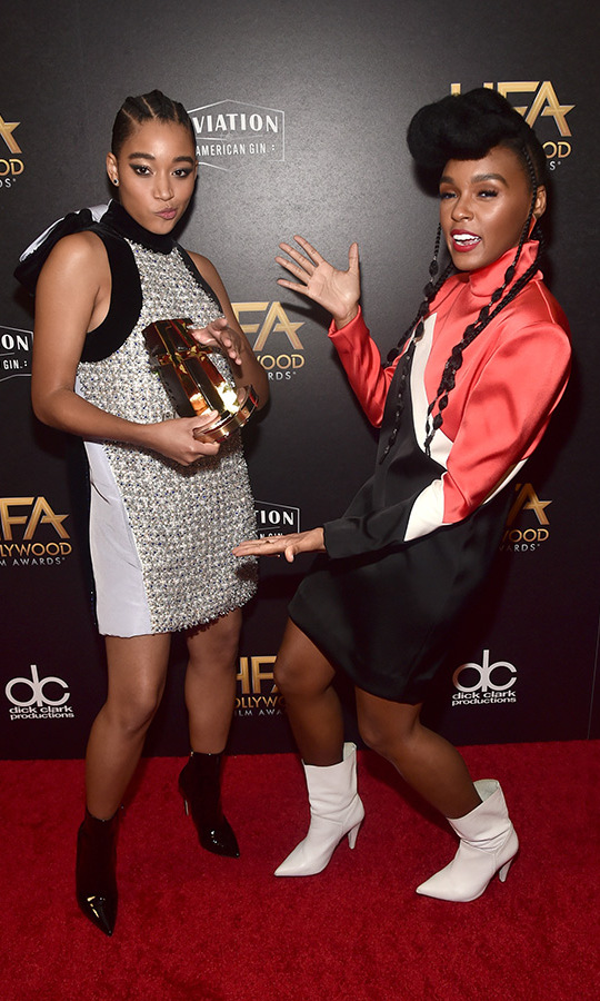 Janelle Monae posed with <em>The Hate U Give</em> star Amandla Stenberg, clad in Ralph Russo Couture, after presenting her with the breakout actress award at the HFAs on Nov. 4. 