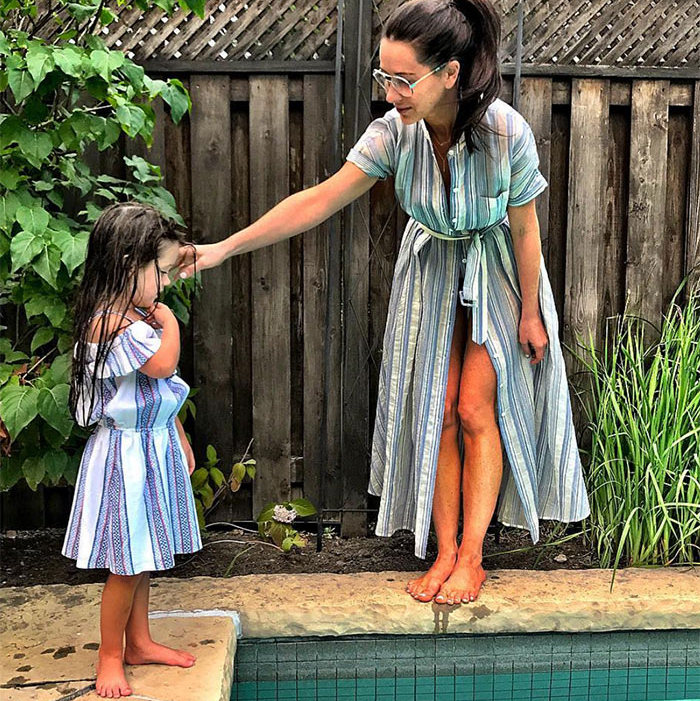 "Even by the pool, this mommy-daughter duo are perfectly in sync. ""Poolside Stripes,"" she wrote on Instagram.