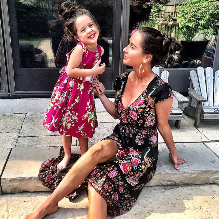 We love this matching sundress and messy bun moment!